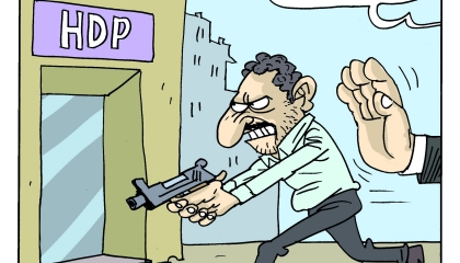كاريكاتير: حكومة أردوغان اليد الخفية وراء الهجوم على مقر حزب الأكراد!