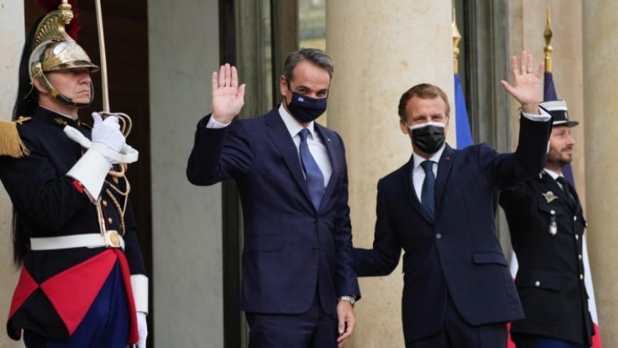 ماكرون ورئيس وزراء اليونان